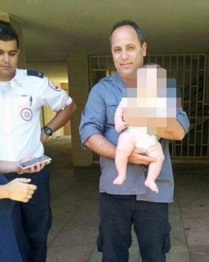 """רס""""ר גילי סיסו והתינוק שחולץ"""