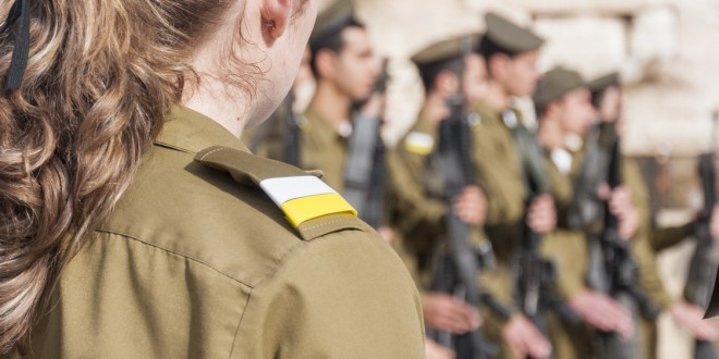 Jerusalem, Israel-Palestine - June 21, 2011: Participants in the Israeli Army's Marva program, which allows young Jews from other countries to receive military training, gather in front of the Western Wall for their graduation ceremony.