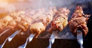 Smoky grilling the marinated pork meat delicious shashlik