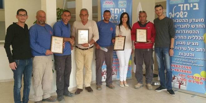 עובדי החברה הכלכלית עם שמואלי ואלקיים (צילום: דוברות ההסתדרות)