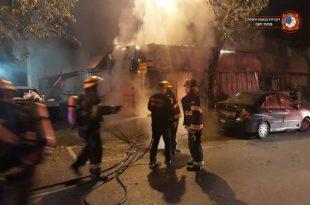 שריפה במבנה בקרית אתא. צילום: דוברות כיבוי והצלה