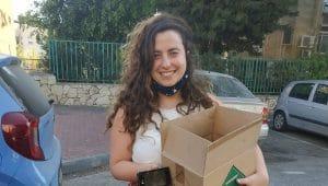 ניצן ברנשטיין, מעמותת עלם בירושלים בעת קבלת התרומה | צילום:יפה מן